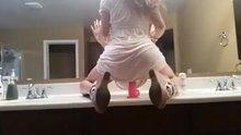 White dress on a suction dildo
