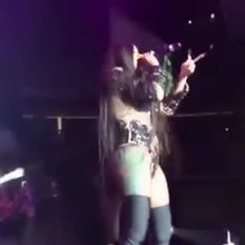 Cardi B claps her ass on stage