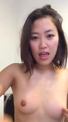 Cute Thai showing tits and blowing kisses