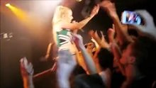 Iggy Azalea dressed as a cheerleader getting groped on stage
