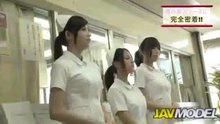 Three nurses blowing a line of patients