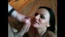 Amateur Milf hates cum, tries to dodge & block facial, ends up covered anyways