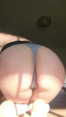 Peeking out from my cute little blue thong ;)