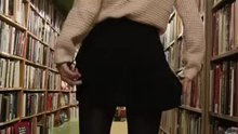 Mallory Christopher flashing in bookstore