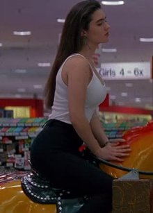 Jennifer Connelly riding a toy horse