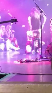 Girl gets eaten out on stage at Steel Panther concert