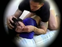 White guy dominates a Japanese girl in bed and finishes in her pussy.