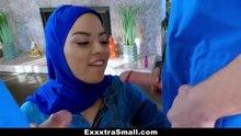 Girl in hijab sucks two cocks