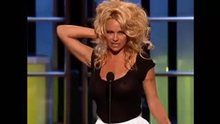 Pamela Anderson wearing a see-thru shirt
