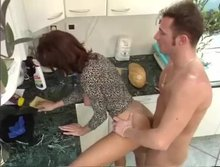 He wants to fuck, she needs to clean the kitchen, why not both at the same time?