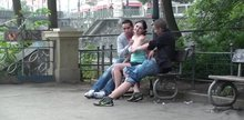 Threesome on a bench with a cute girl