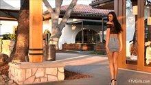 Marley Brinx flashing in front of a restaurant